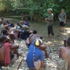 Researchers talking to people from Aitape in Papua New Guinea